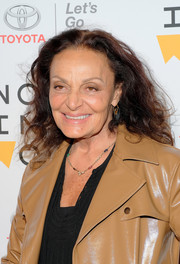 Diane von Furstenberg attended the 2018 Women in the World Summit wearing her signature shoulder-length curls.