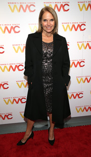 Katie Couric layered a black wool coat over a gunmetal cocktail dress for the 2018 Women's Media Awards.