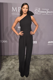 Lais Ribeiro donned a black Dsquared2 one-shoulder jumpsuit with oversized bow detail for the 2018 amfAR Gala New York.