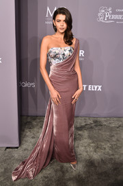 Georgia Fowler cut an ultra-feminine figure in a mauve Vivienne Westwood one-shoulder gown with a contrast corseted bodice at the 2018 amfAR Gala New York.