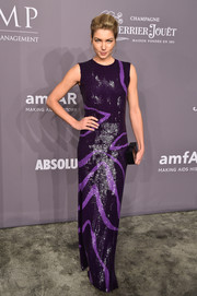 Jessica Hart was svelte and elegant in a Jeffrey Dodd sequin gown in two shades of purple at the 2018 amfAR Gala New York.