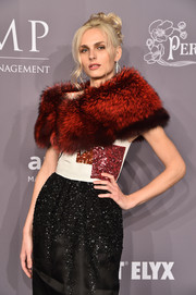 Andreja Pejic paired a red fur stole with a beaded tricolor gown for total glamour at the 2018 amfAR Gala New York.