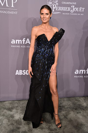 Heidi Klum paired her gorgeous dress with strappy black heels by Neil J. Rodgers.