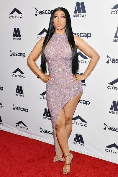 Cardi B sealed off her look with a pair of silver triple-strap sandals.