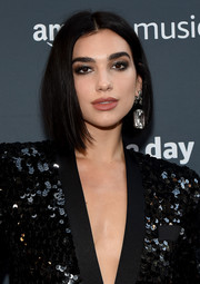 Dua Lipa sealed off her look with a massive crystal earring.
