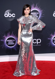 Sofia Carson looked downright dazzling in an asymmetrical silver sequined gown by Francesco Scognamiglio at the 2019 American Music Awards.