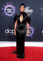 Regina King went for sultry glamour in a black cold-shoulder, keyhole-cutout gown by Ashi Studio Couture at the 2019 American Music Awards.