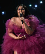 Lizzo paired a silver glitter mani with a magenta tulle gown for her performance at the 2019 AMAs.