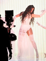 Camila Cabello amped up the sex appeal with a pair of white lace stockings.