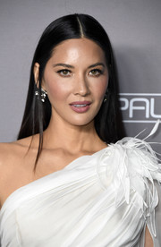 Olivia Munn kept it simple yet elegant with this straight center-parted style at the 2019 Baby2Baby Gala.