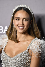 Jessica Alba matched her dress with a pearl-studded headband.