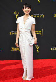 Marie Kondo coordinated her dress with a bejeweled white clutch by Jimmy Choo.