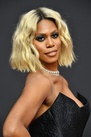Laverne Cox went for a short blonde wavy hairstyle at the 2019 Creative Arts Emmy Awards.