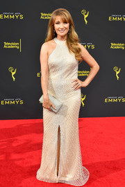 Jane Seymour paired her outfit with a metallic silver clutch.