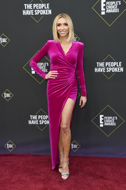Giuliana Rancic showed off her svelte figure in a ruched fuchsia wrap dress by Alexandre Vauthier at the 2019 E! People's Choice Awards.