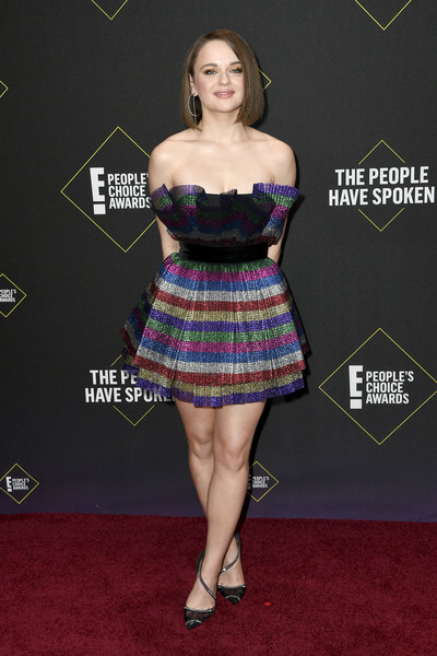 Joey King finished off her outfit with bedazzled black pumps by Christian Louboutin.
