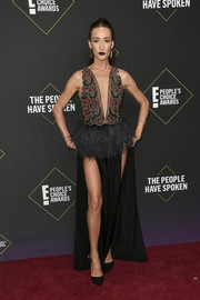 Maggie Q donned a sexy gown with a beaded bodice, a plunging neckline, double slits, and a feathered peplum waist for the 2019 E! People's Choice Awards.