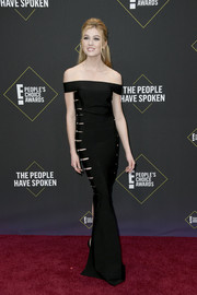 Katherine McNamara looked alluring in a slashed off-the-shoulder column dress by Azzaro Couture at the 2019 E! People's Choice Awards.