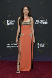 Sarah Hyland flashed some leg in a beaded orange Fausto Puglisi gown with two hip-high slits at the 2019 E! People's Choice Awards.