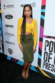 Laura Harrier layered a yellow Victor Glemaud cardigan over a matching crop-top for the 2019 Essence Black Women in Hollywood Awards.