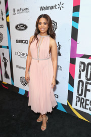Regina Hall was sweet and sexy at once in a pleated pink Reem Acra dress with a deep-V cutout and silver trim at the 2019 Essence Black Women in Hollywood Awards.