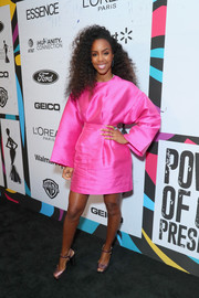Kelly Rowland complemented her dress with rose-gold platform sandals.