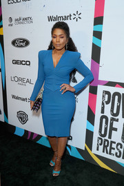 Angela Bassett attended the 2019 Essence Black Women in Hollywood Awards wearing a strong-shouldered blue sheath dress by Greta Constantine.