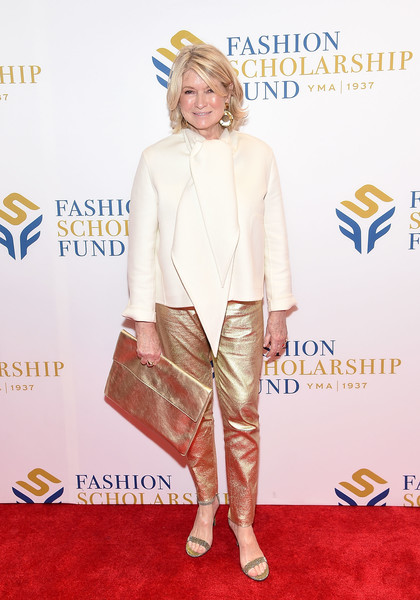 Martha Stewart's oversized gold clutch was a perfect match to her pants.