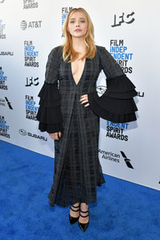 Chloe Grace Moretz attended the 2019 Film Independent Spirit Awards wearing a gray plaid dress with tiered bell sleeves.