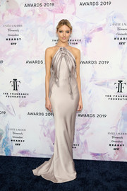 Martha Hunt looked divine in a slinky gray halter gown by Jason Wu at the 2019 Fragrance Foundation Awards.