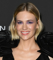 January Jones got playful with her makeup. She chose an eye-catching purple hue, in a thick application, for her eyes.