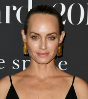 Amber Valletta opted for a simple bun when she attended the 2019 InStyle Awards.