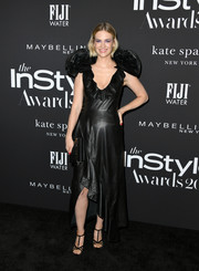 January Jones teamed her frock with black T-strap sandals.