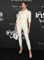 Olivia Culpo went the minimalist route in a cream pantsuit by Dior at the 2019 InStyle Awards.