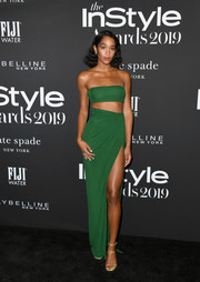 Laura Harrier bared lots of skin in a green bandeau top by Brandon Maxwell at the 2019 InStyle Awards.