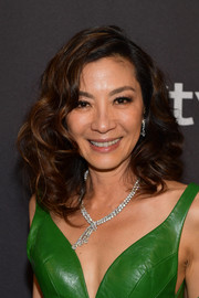 Michelle Yeoh rocked high-volume curls at the InStyle and Warner Bros. Golden Globes after-party.