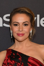 Alyssa Milano looked elegant wearing this loose bun at the InStyle and Warner Bros. Golden Globes after-party.