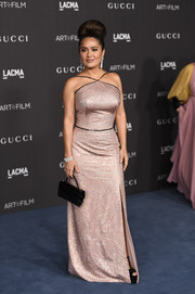 Salma Hayek paired her dress with a black patent purse.