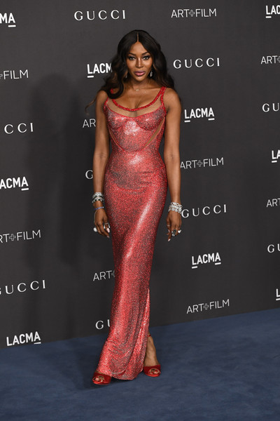 Naomi Campbell polished off her look with red peep-toe heels by Christian Louboutin.
