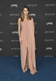 Suki Waterhouse kept it low-key yet elegant in a dusty-pink one-shoulder gown by Gucci at the 2019 LACMA Art + Film Gala.