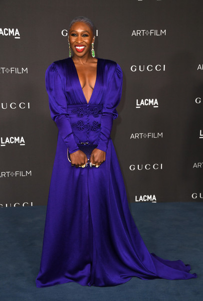 Cynthia Erivo made a grand entrance at the 2019 LACMA Art + Film Gala in a purple Gucci gown with a plunging neckline and leg-of-mutton sleeves.