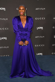 Cynthia Erivo matched her dress with a purple sequined clutch.