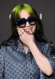 Billie Eilish finished off her look with some gold rings.