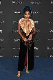 Amandla Stenberg chose a tricolor Gucci gown that was rendered in layers of pleated silk and velvet for the 2019 LACMA Art + Film Gala.