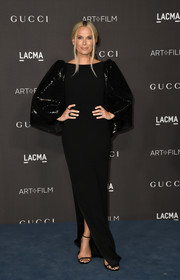 Molly Sims went for understated elegance in a black Alex Perry gown with sequined bell sleeves at the 2019 LACMA Art + Film Gala.