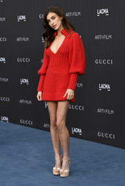 Rainey Qualley styled her frock with studded T-strap platforms, also by Gucci.