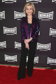 Jane Fonda kept the rest of her look simple with black wide-leg pants and a matching top.