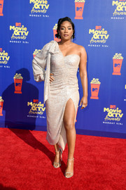Tiffany Haddish got glam in a ruched gold one-shoulder dress by Jonathan Simkhai for the 2019 MTV Movie and TV Awards.