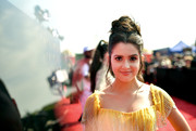 Laura Marano styled her hair into a loose, high bun for the 2019 MTV Movie and TV Awards.