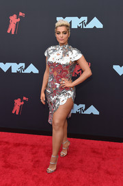 Bebe Rexha matched her dress with silver triple-strap sandals by Giuseppe Zanotti.